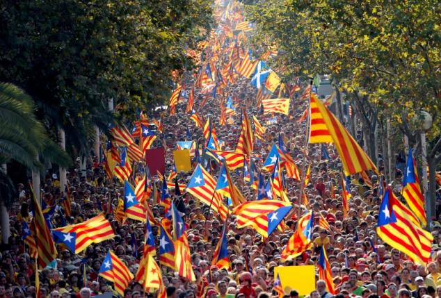 "People hold Catalan separatist flags known as ""Esteladas"" during a gathering to mark the Calatalonia day ""Diada"" in central Barcelona, Spain, September 11, 2014. REUTERS/Albert Gea/File Photo"